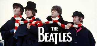 The Beatles wearing a football scarf